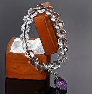 Faceted Natural Quartz Rock Crystal Beads Stretch Bracelet with Stunning Hand-Carved Amethyst Skull
